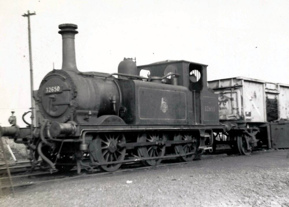Terrier 32650 in siding with coal wagon at the coaling stage. Michael Harvey collection