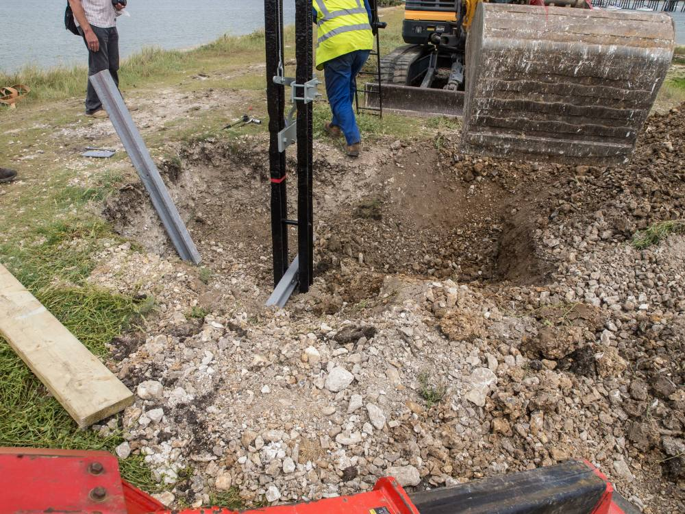 The first layer of infill has been dropped into the excavation up to the bull head rail secured to the signal post.