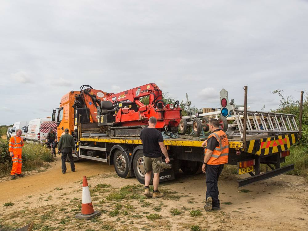 The flat bed truck containing the tracked crane, trolley and signal arrives at the worksite
