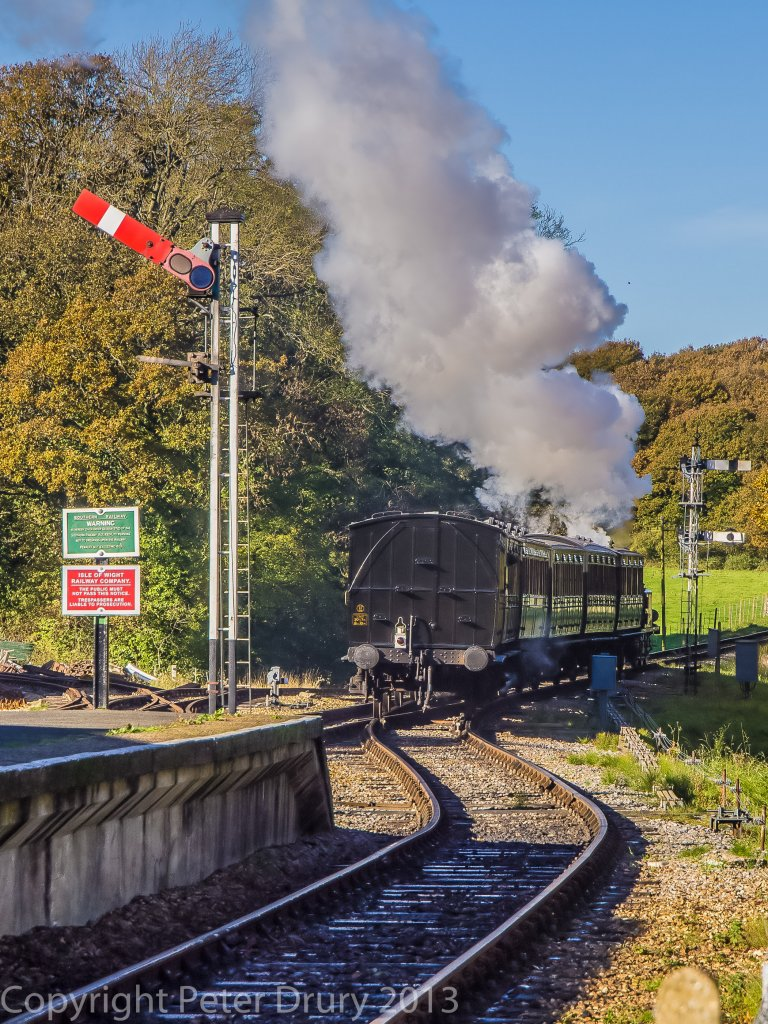 !0 Nov 2013. No8 'Freshwater' and train departing for Wooten. The carriages dwarf the terrier.